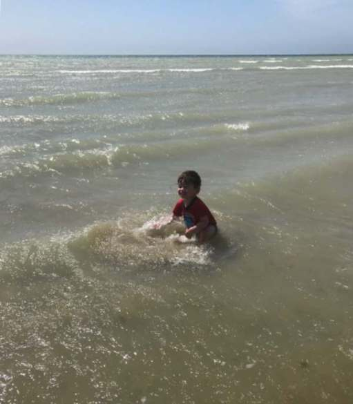 Little Jay playing in the sea at Worthing!