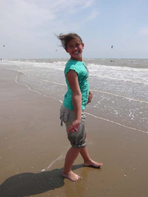 Jasmine about to go in the water at Camber Sands.