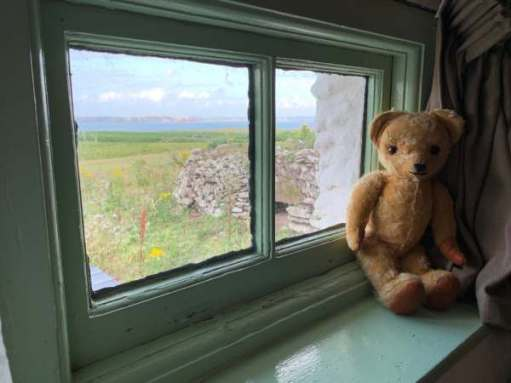 Eamonn sat on the windowsill admiring the view across Skokholm.