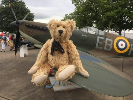 Bertie sitting on the wing of a Spitfire. Duxford. Last day of summer, 2016.