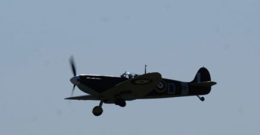 Spitfire in the air at Duxford, 2019.
