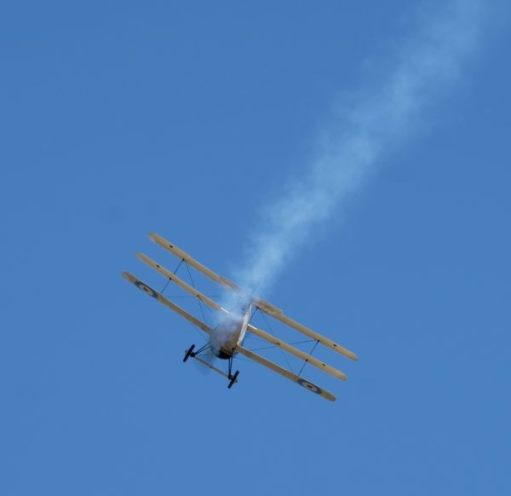 Rear view of a Sopwith Triplane, faking smoke at Duxford Airshow 2019.
