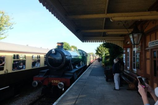 West Somerset Railway - Blue Anchor Station, with 6960 Raveningham Hall pulling in, alongside another train on the opposite platform.