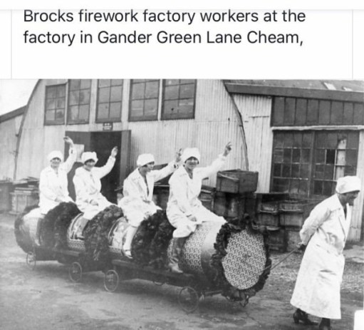 Brocks Fireworks factory workers at the factory in Gander Green Lane, Cheam. Picture of 5 ladies in front of a hut. 4 of them are being pulled on some sort of trolley by the fifth.