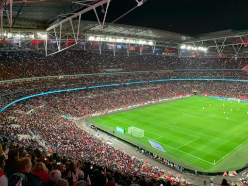 Fans with their phone lights on supporting the Lionesses at a packed Wembley Stadium.