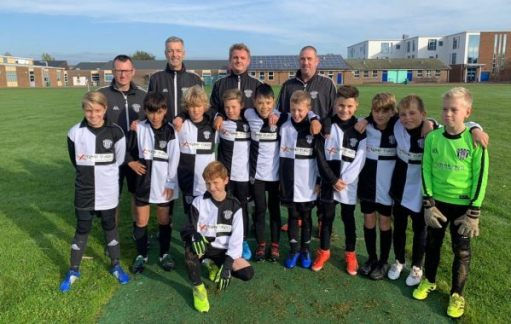 East Preston U11 football team and coaches.
