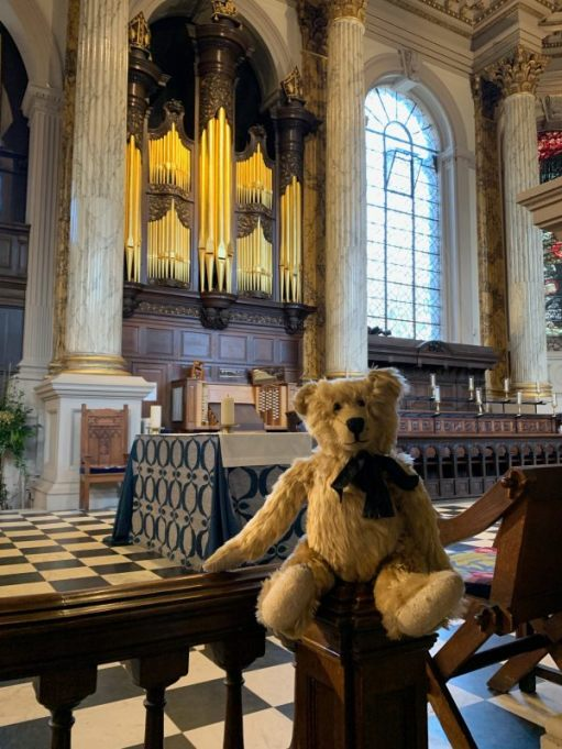 Bertie sat in the choir with the organ behind. There are a mass of ornate, gold-coloured pipes in a beautiful carved wooden surround.