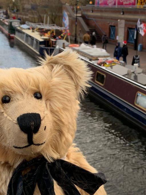 Bertie, with some of the boats from teh Floating Christmas Market behind.