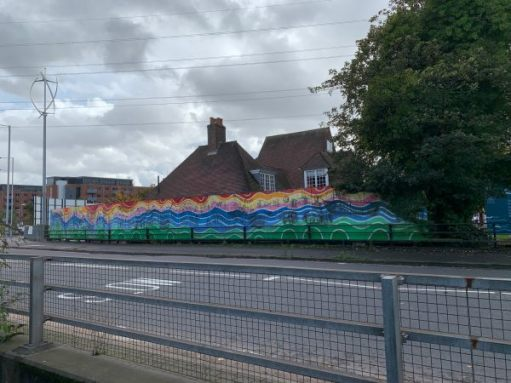 Colourful hoardings on the other side of the road.