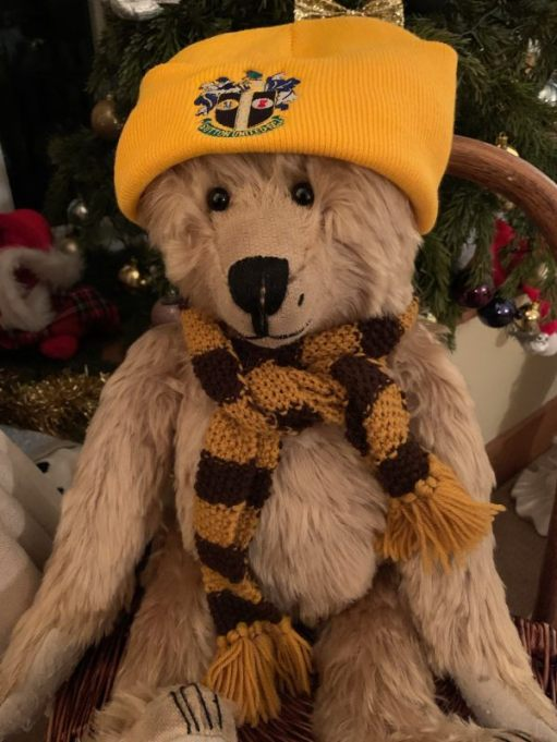 Bertie wearing his new Sutton United hat.