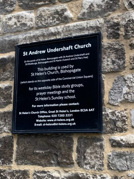 Noticeboard explaining that St Andrew Undershaft Church is now used by St Helen's Church, Bishopgate.