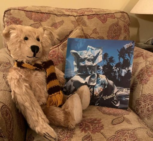 Bertie sat in a comfy armchair alongside the album sleeve of 'Bloody Tourists'.