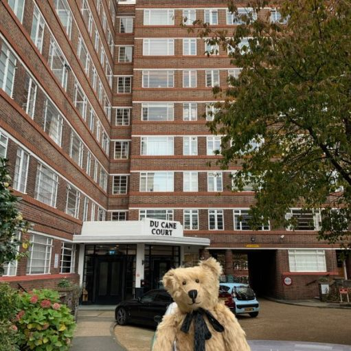Bertie in front of one of the entrances to Du Cane Court.