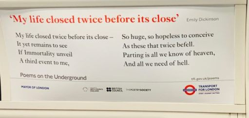 Poem poster on an Underground train.