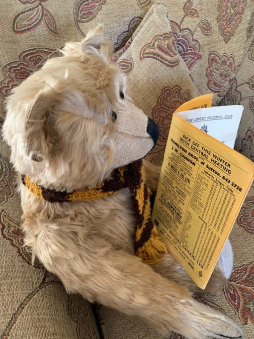 Bertie reading the programme - and an advert for central heating!