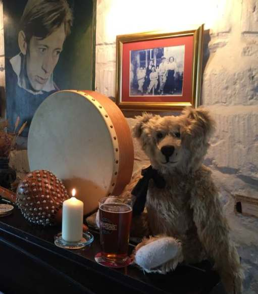 Lighting a candle for Diddley: Bertie at Laurie Lee's bar in the Woolpack at Slad.