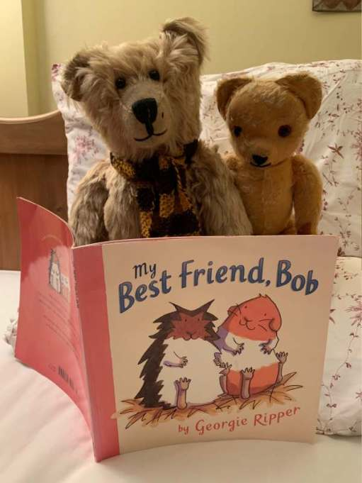 "Bertie and Eamonn reading a book ""My Best Friend, Bob"" by George Ripper."