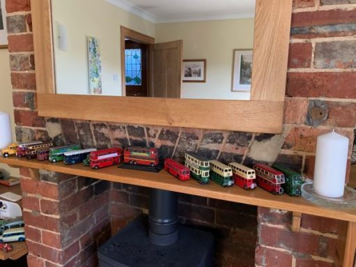 A mantlepiece displaying model buses.