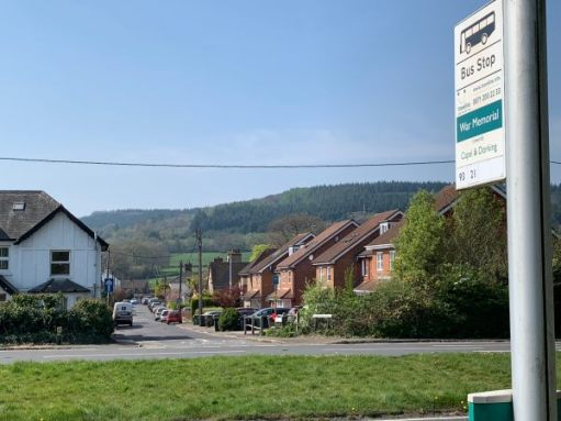 Here's the bus stop and you can see Vitae Cottage with the hills of Redlands beyond.