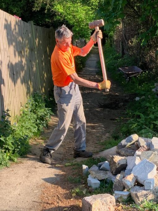 Mattock Mike (with a sledgehammer breaking up concrete).