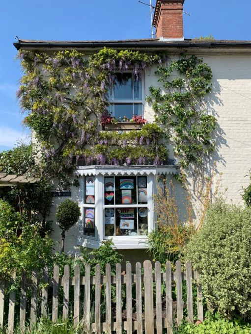 """The start. Laurel Cottage (LC) with the wisteria in full flower and """"Bertie's Window"""", dedicated to rainbows from grandchildren and the NHS."""