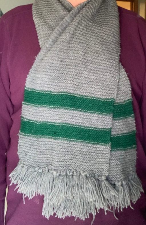 """The Cheam Park Farm Primary School scarf. Grey, with two green """"tramlines"""" across the ends."""
