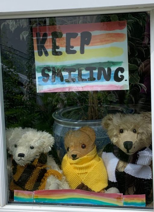 Eamonn sat in the window of Laurel Cottage wearing his new scarf, with Trevor on the left wearing his black and yellow striped scarf and Bertie modelling the new Black and White one.