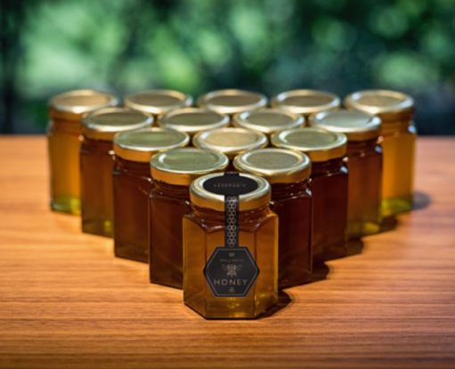 Jars of Rolls-Royce honey, laid out in a triangle.