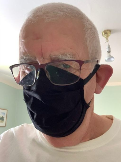 Bobby's wearing a black face mask.