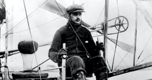 Charles Rolls piloting his biplane across the English Channel.