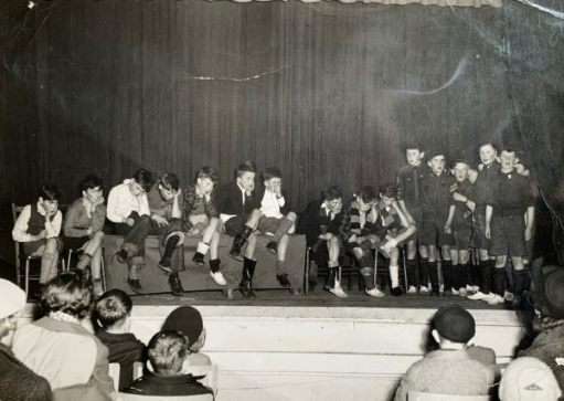 Bobby and some of the scouts performing a sketch on stage.