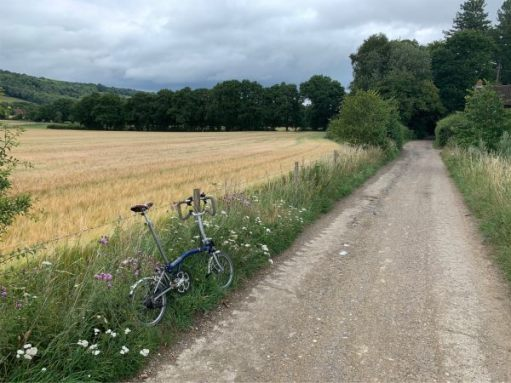 July 2020. Cycling down NCN Route 22 again. Full of memories. Denbies Hillside high left.