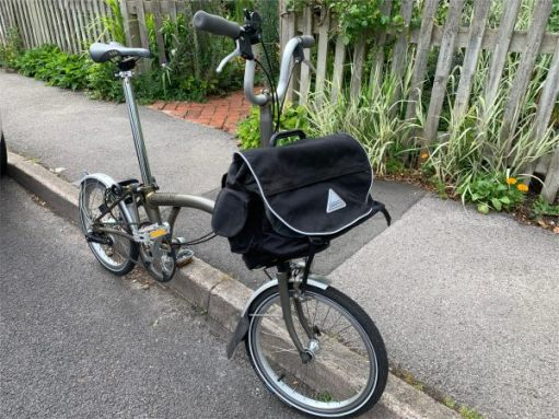 The Brompton stood up against the kerb.