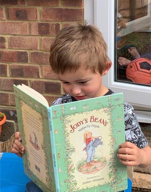 Little Jay. Jasmine's son reading Jody's Beans.
