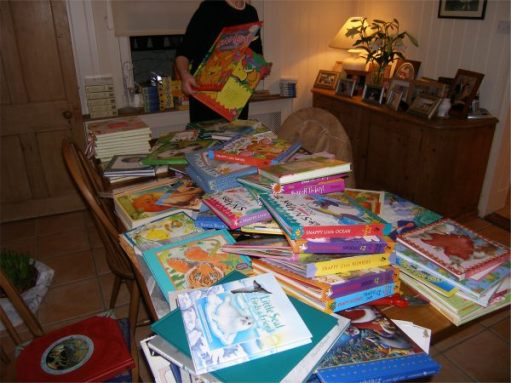 Diddley bringing the books in and covering a big table with them.