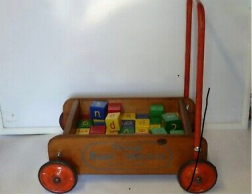 An old fashioned wooden baby walker.