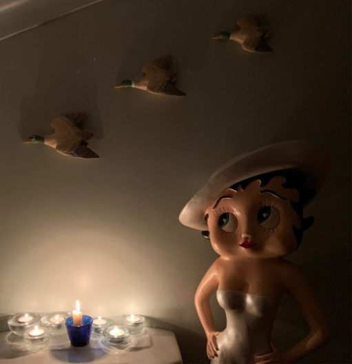 Betty Boop, several candles lit for Diddley and the three flying ducks on the wall.