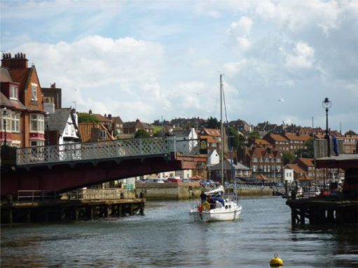 Just one half of the swing bridge open for a yacht.