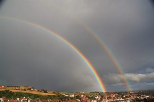 The end of the storm. Taken from the cottage. Two brilliant rainbows against the black clouds.
