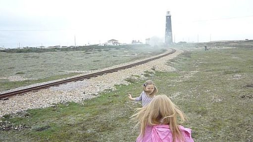 Waving at trains on the Romney Hythe and Dymchurch Railway.