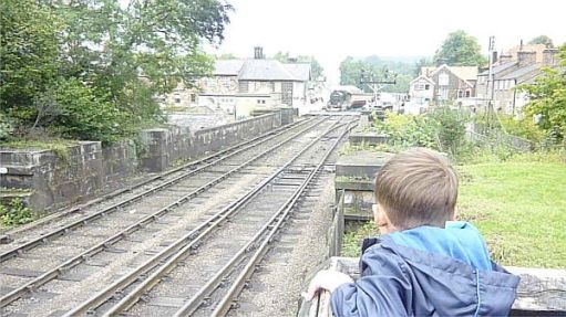 Waving at trains on the North Yorkshire Moors Railway.