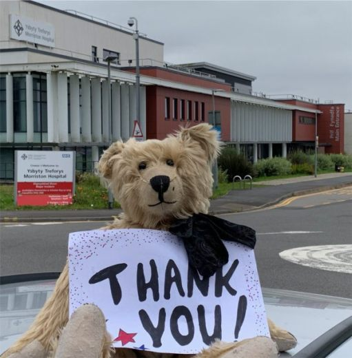 "One Foot in the Grave: Bertie outside the Morriston Hospital, Swansea, holding a sign saying ""Thank you!"""
