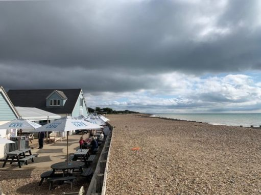 The Bluebird Café on Ferring Seafront, looking along the beach with the sea on the right.