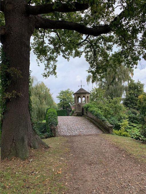A mile long drive and here is the bridge into Dunsborough Park garden.