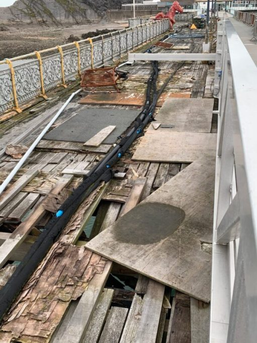 Old decking on Mumbles Pier in a very poor state of repair.