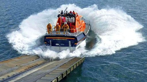 "Mumbles lifeboat ""Roy Barker IV"" splashing into the sea at the end of the slipway."
