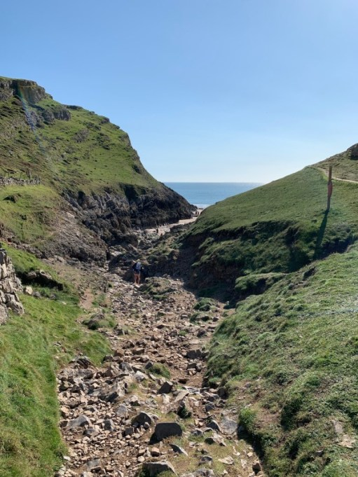 The rocky gulley down to the beach.