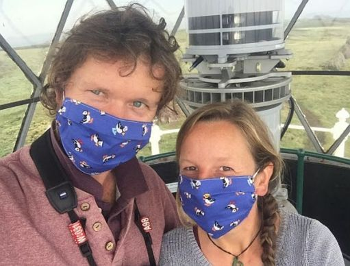 Richard and Giselle wearing their Puffin facemasks!