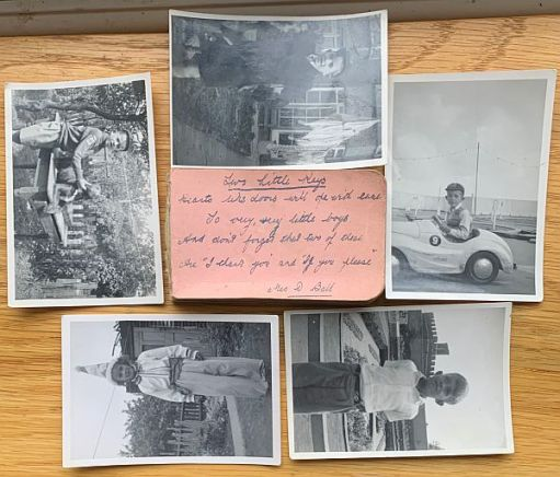"Family history photographs with a pink ""Post It"" note."
