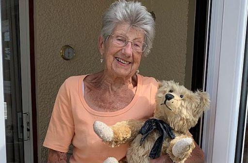 Rosemary, outside her front door, holding Bertie.